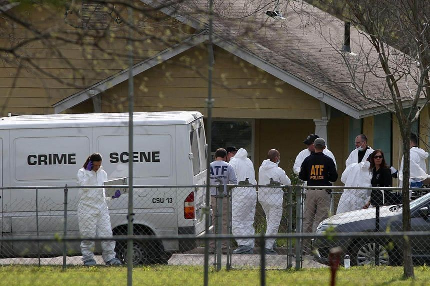 Law enforcement personnel seen outside the home of Austin serial bomber Mark Conditt in Pflugerville, Texas, on March 22, 2018.