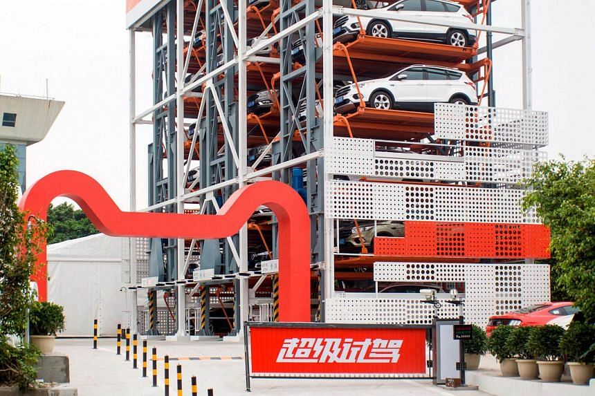 The  car vending machine in Guangzhou  contained 42 cars of various models, including the Ford Explorer and Mustang.