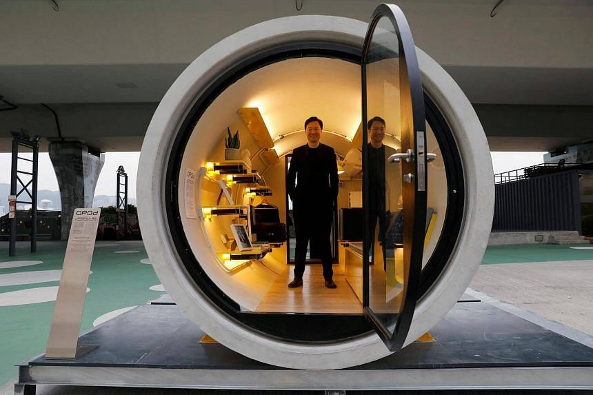 Architect James Law posing inside Opod, a 120-square-ft giant water pipe, designed as micro-housing in Hong Kong, on Dec 14, 2017.