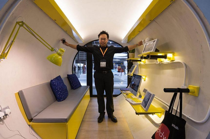 Jonathan Kong, standing inside the OPod Tube House display during the Design Inspire exhibition in Hong Kong, on Dec 8, 2017.