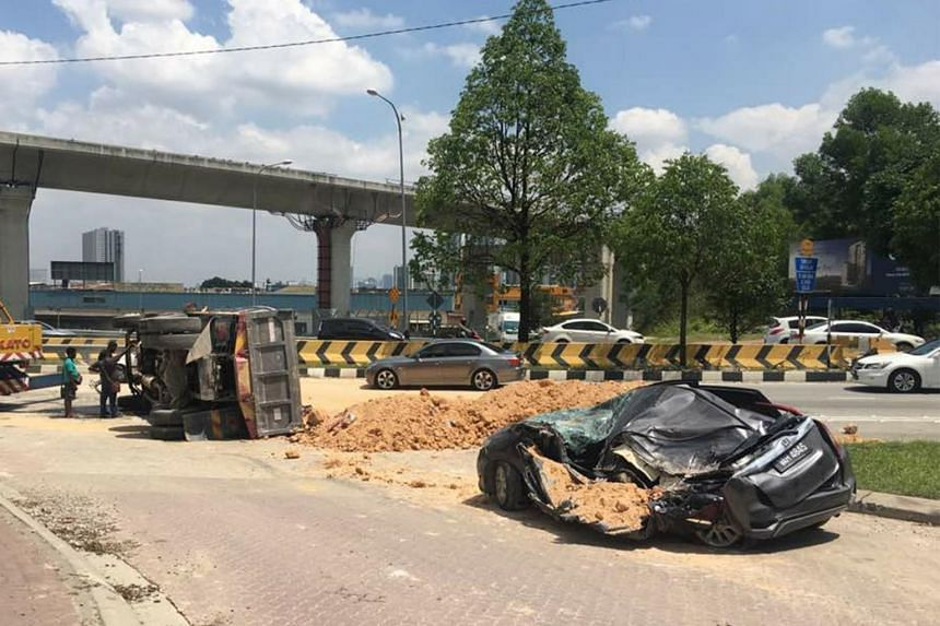 The police officer was driving along Jalan Bukit Jalil when a lorry lost control and overturned.