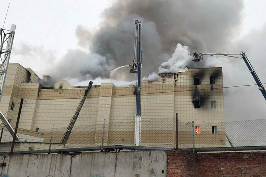 Firefighters extinguishing a fire at a shopping mall in Kemerovo, Russia, on March 25, 2018.