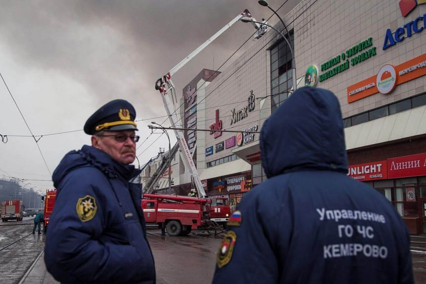Members of the Emergency Situations Ministry working at the scene of a fire in a shopping mall in the Siberian city of Kemerovo, Russia, on March 25, 2018.