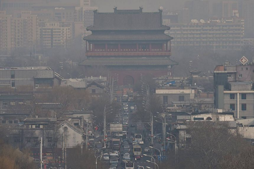 Beijing's Drum Tower is seen through smog on March 12, 2018.
