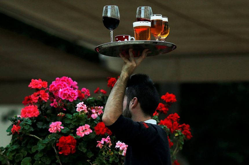 """A file photo of a waiter at a restaurant. Waiter Guillaume Rey filed a complaint with British Columbia's Human Rights Tribunal against his former employer, claiming """"discrimination against my culture""""."""
