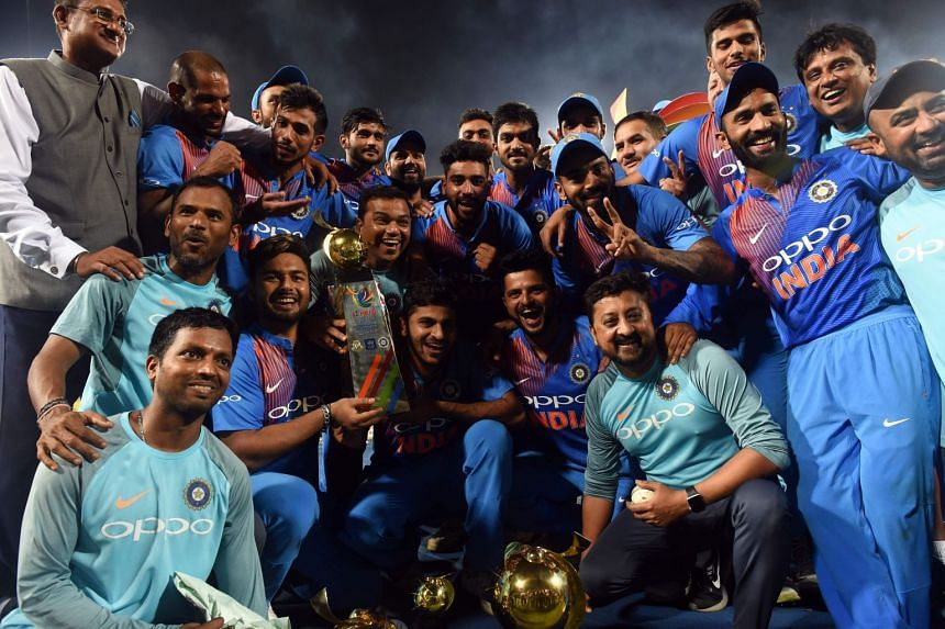 Indian players celebrating their victory over Bangladesh with the Nidahas Twenty20 Tri-Series international cricket trophy on March 18, 2018.