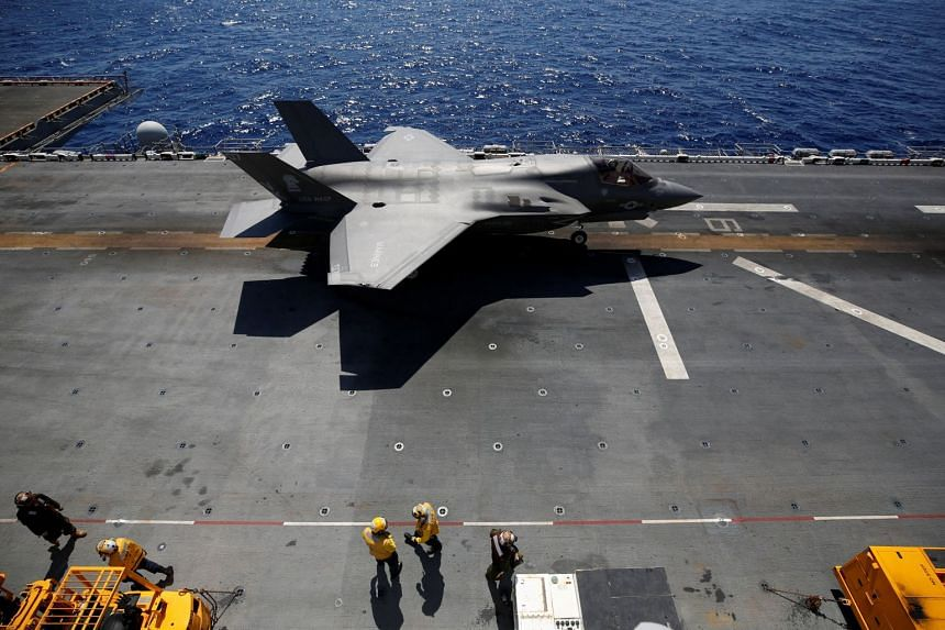 A Lockheed Martin F-35B preparing for take-off on the flight deck of the amphibious assault carrier USS Wasp, in waters off Okinawa, on March 23, 2018.