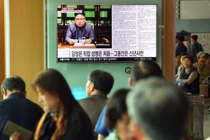 People watch a television news screen showing a picture of North Korean leader Kim Jong-Un delivering a statement in Pyongyang, at a railway station in Seoul on Sept 22, 2017.