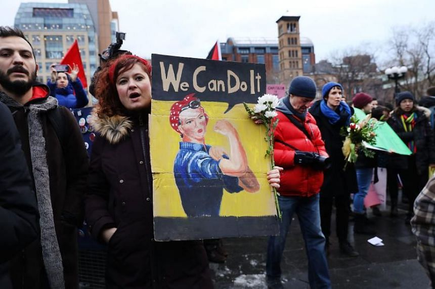 Dozens of women and men attend a rally and march in Washington Square Park for international Women's Day on March 8, 2018 in New York City.