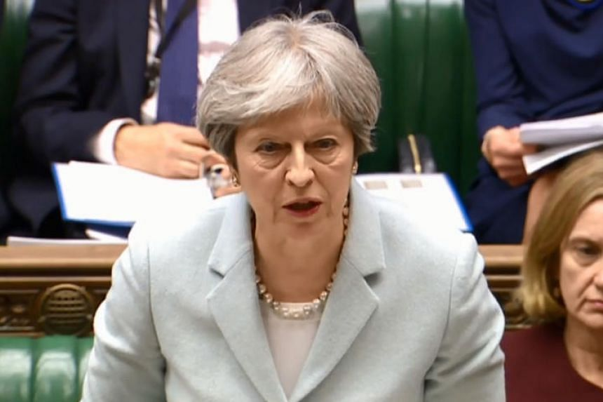A video grab from footage broadcast by the UK Parliament's Parliamentary Recording Unit (PRU) shows Britain's Prime Minister Theresa May making a statement on Russia and the European Council in the House of Commons in London on March 26, 2018.