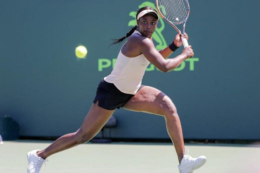 Sloane Stephens of the US in action against Garbine Muguruza of Spain during a fourth round match at the Miami Open tennis tournament on Key Biscayne, Miami, Florida, US, on March 26, 2018.
