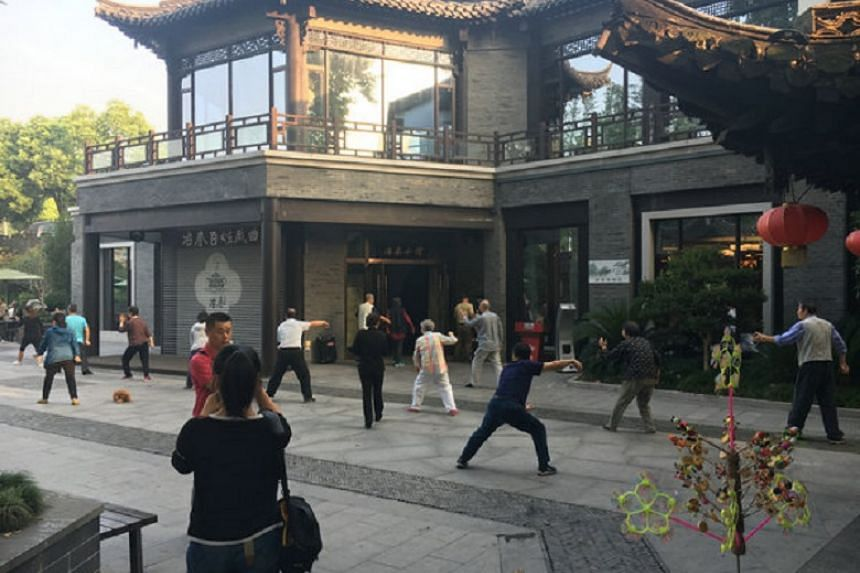 Elderly men and women practice taiji in the early morning at an open area in front of Ye Chun Teahouse, a popular eatery in Yangzhou, Jiangsu province.