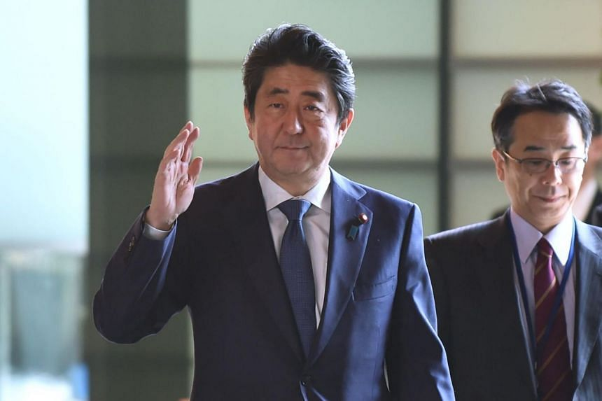 Japan's Prime Minsiter Shinzo Abe arrives at his official residence to attend a cabinet meeting in Tokyo on March 27, 2018.
