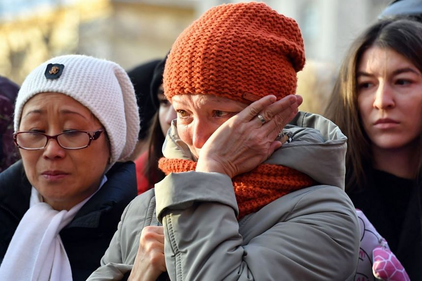 People gather at a makeshift memorial in Moscow to pay tribute to the victims of the fire.