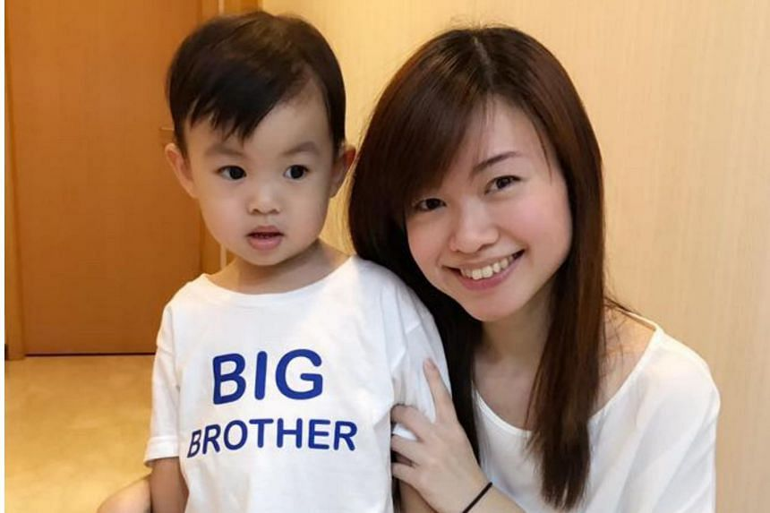 """Member of Parliament Tin Pei Ling made the announcement on Facebook by posting a photo of her firstborn son dressed in a shirt with the words """"Big Brother"""" emblazoned on it."""