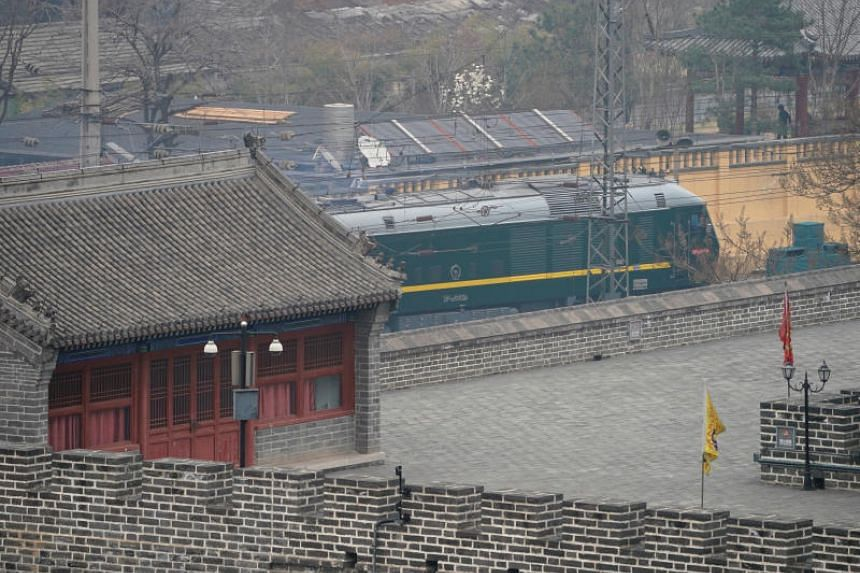 A train believed to be carrying a senior North Korean delegation leaves the Beijing Railway Station in Beijing, China, March 27, 2018.