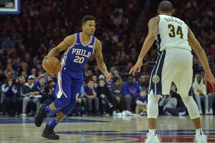 Philadelphia 76ers guard Markelle Fultz (left) brings the ball up the court against Denver Nuggets guard Devin Harris during their NBA game on March 26, 2018.
