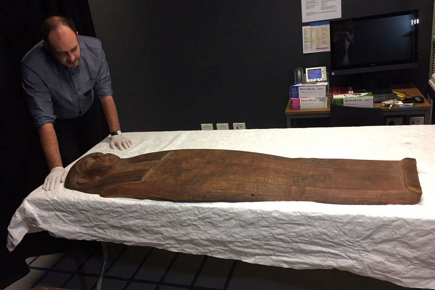 A 2,500-year old coffin that may contain a mummy lies at the University of Sydney on March 27, 2018.