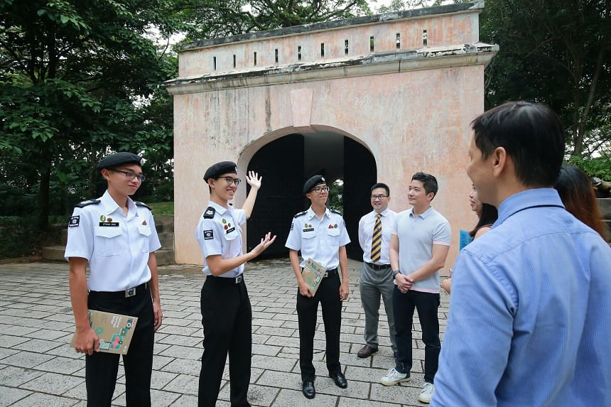 Students (from left) Ethan Ong, Jonathan Lim and Ethan Christian Tan from the St John uniformed group sharing about Fort Canning Gate as part of their heritage trail projects.