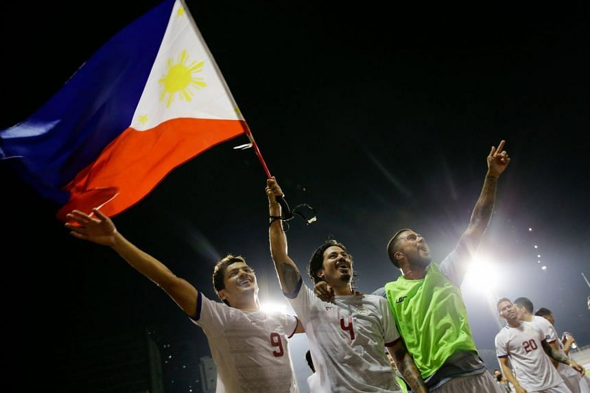 Players from the Philippines celebrate their win after the 2019 AFC Asian Cup Qualification Final Round soccer match between the Philippines and Tajikistan at the Rizal Memorial Stadium in Manila, Philippines, on  March 27, 2018.