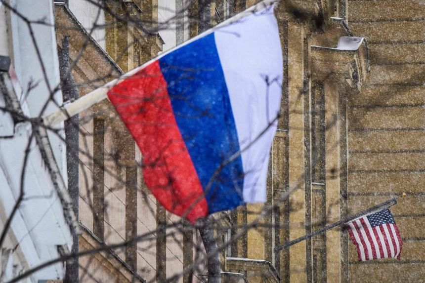 A Russian flag flies next to the US embassy building in Moscow on March 27, 2018.