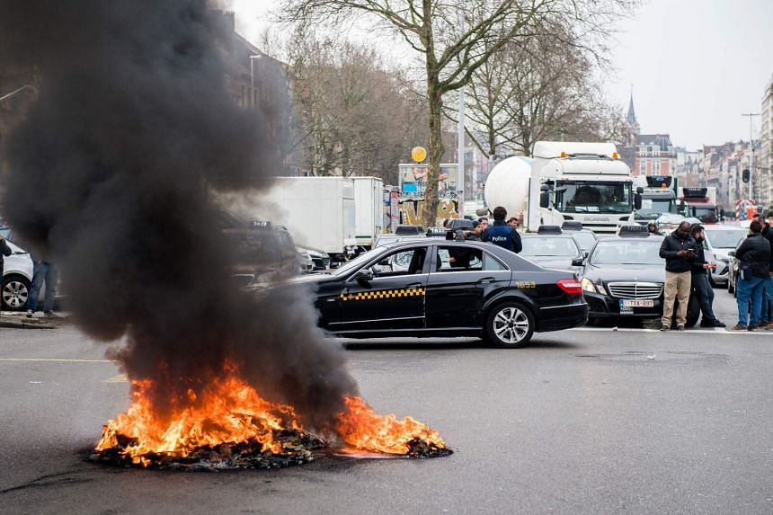 As many as 650 taxis taking part in the protest let off fireworks and blocked traffic on major roads in and around Brusels on March 27, 2018.