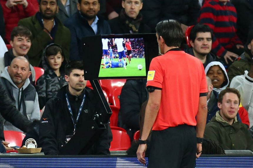 Referee Deniz Aytekin of Germany looking at the VAR during the International friendly match between England and Italy.