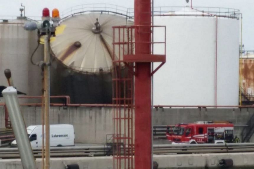 Firefighters arrive at the site of the explosion of a fuel tank at the industrial port in Livorno, Italy.