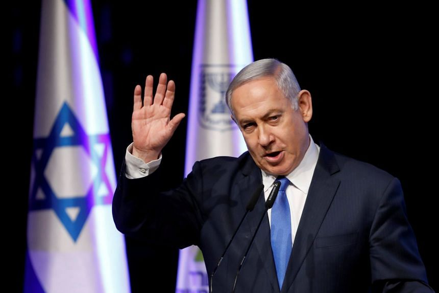 Netanyahu gestures as he addresses a health conference in Tel Aviv, March 27, 2018.
