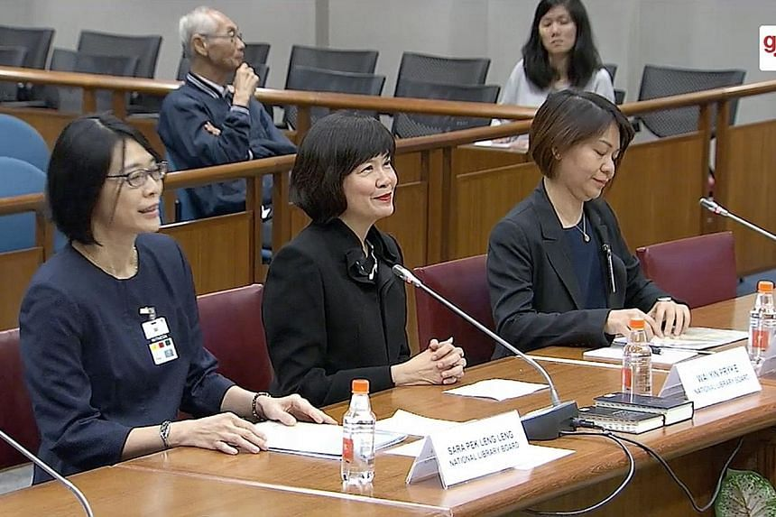 The National Library Board's director Wai Yin Pryke (centre) at the hearing yesterday, with senior manager for engagement Sara Pek Leng Leng (far left) and assistant director for content and services, general reference, and statutory and digital cont