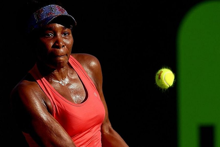 Venus Williams returning a shot during her defeat of Johanna Konta at the Miami Open in Key Biscayne, Florida, to reach the quarter-finals. Defending champion Konta won the first set but needed several injury time-outs, which disrupted her rhythm.