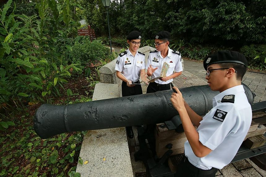 Students (from left) Jonathan Lim, Ethan Ong and Ethan Christian Tan from the St John uniformed group at Anglo-Chinese School (Independent) checking out a cannon at Fort Canning Hill, which was a landmark covered under their heritage trail projects.