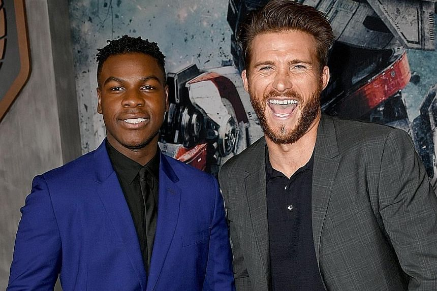 John Boyega and Scott Eastwood (both above) star in Pacific Rim: Uprising (top).