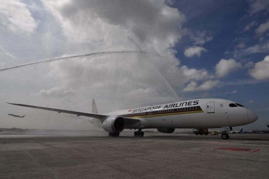Singapore Airlines' Boeing 787-10 Dreamliner receiving a water cannon salute on its arrival in Singapore on March 28, 2018. The salute is reserved for significant aviation events. SIA is the first airline to operate the latest variant of the Dreamlin