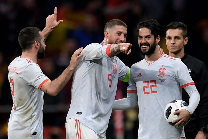 Defenders Dani Carvajal and Sergio Ramos and midfielder Isco celebrate after the match.