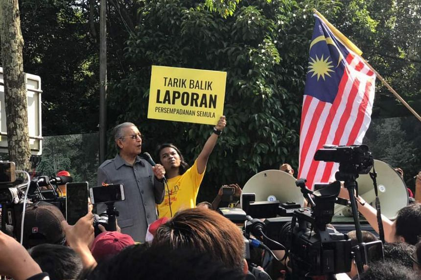 Malaysia's former Prime Minister Mahathir Mohamad speaking to protesters outside Parliament in Kuala Lumpur on March 28.