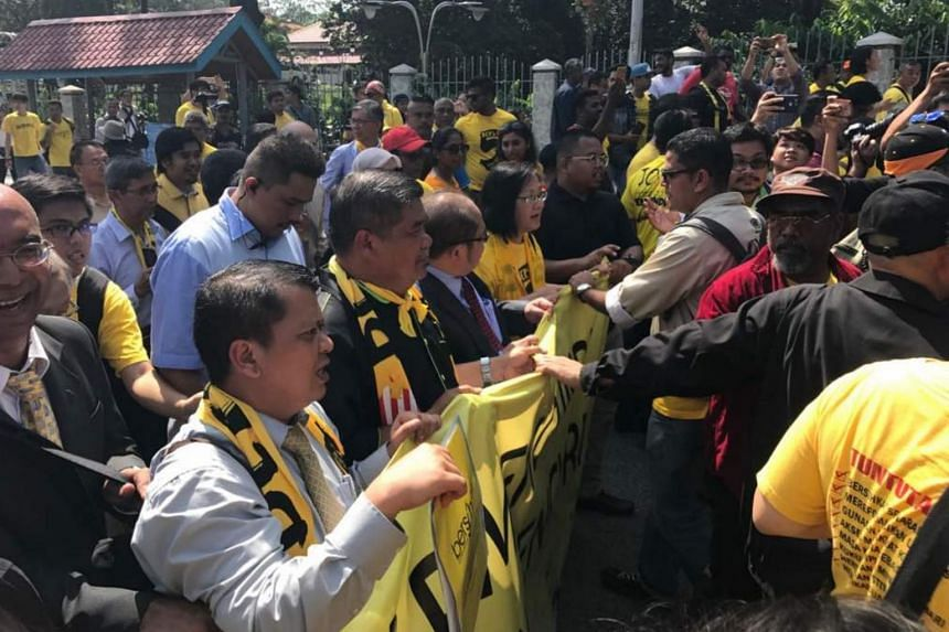 Hundreds of supporters of the Malaysian electoral reform group Bersih gathering outside Parliament in Kuala Lumpur on March 28 to protest against the tabling of changes to the country's electoral boundaries.