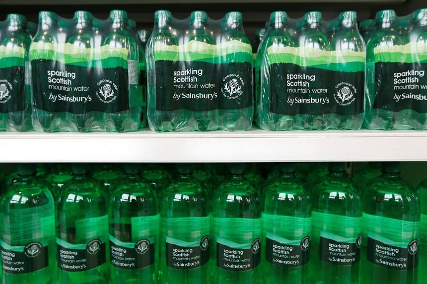 Bottles of Sainsbury's sparkling water are displayed in a store in Redhill, Britain, on March 27, 2018.