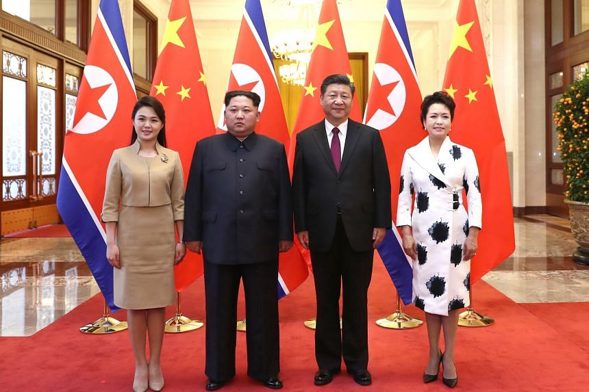 China's President Xi Jinping (second from right) with his wife Peng Liyuan (right) also held a welcome banquet for North Korean leader Kim Jong Un (second from left) and his wife Ri Sol Ju.