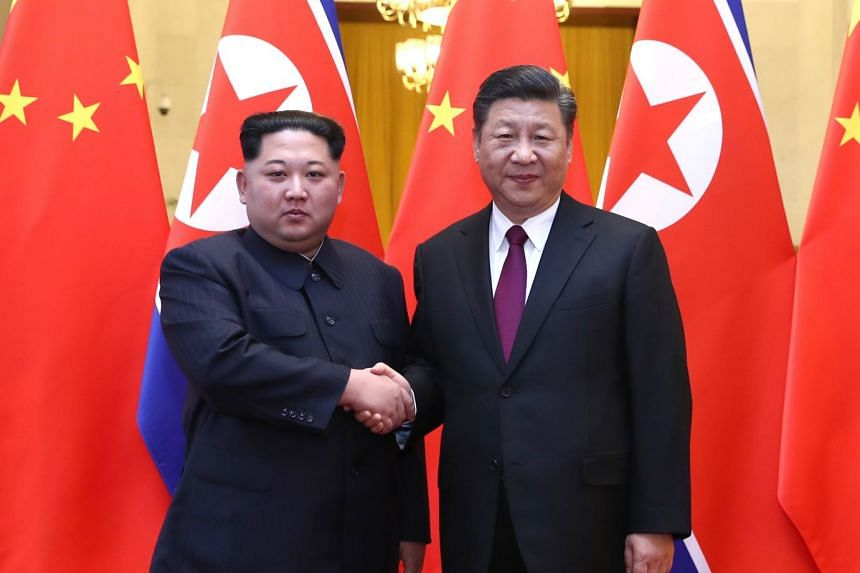 China's President Xi Jinping (right) held talks with North Korean leader Kim Jong Un at the Great Hall of the People in Beijing, Xinhua reported.