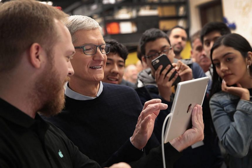 Apple CEO Tim Cook using Apple's new iPad, on March 27, 2018.