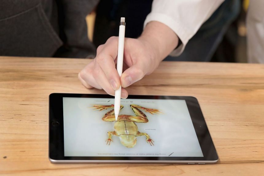The new 9.7-inch iPad is used to demonstrate the dissecting of a frog during an event held at Lane Tech College Prep High School, on March 27, 2018