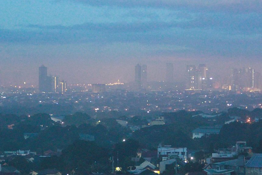 Smog obstructing the view of the skyline in Antipolo city, Philippines, on Jan 1, 2017.