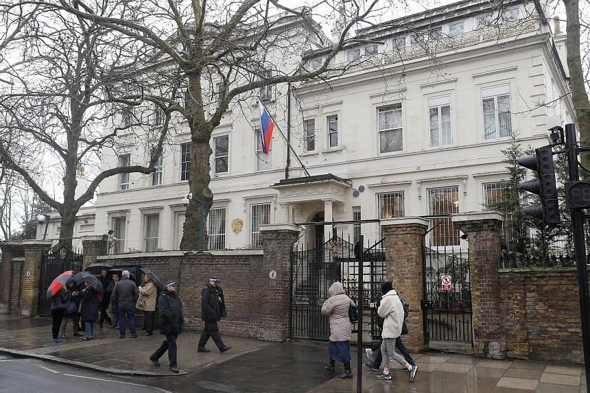 Police officers walking past the Russian embassy in London, Britain, on March 12, 2018.