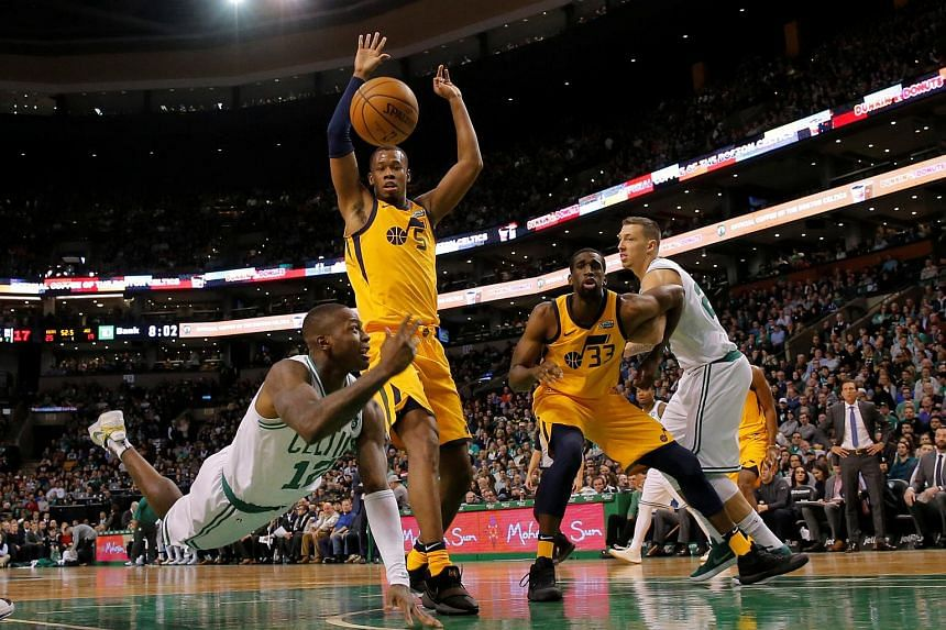 Boston Celtics guard Terry Rozier (12) works the ball against Utah Jazz guard Rodney Hood (5) in the first quarter.