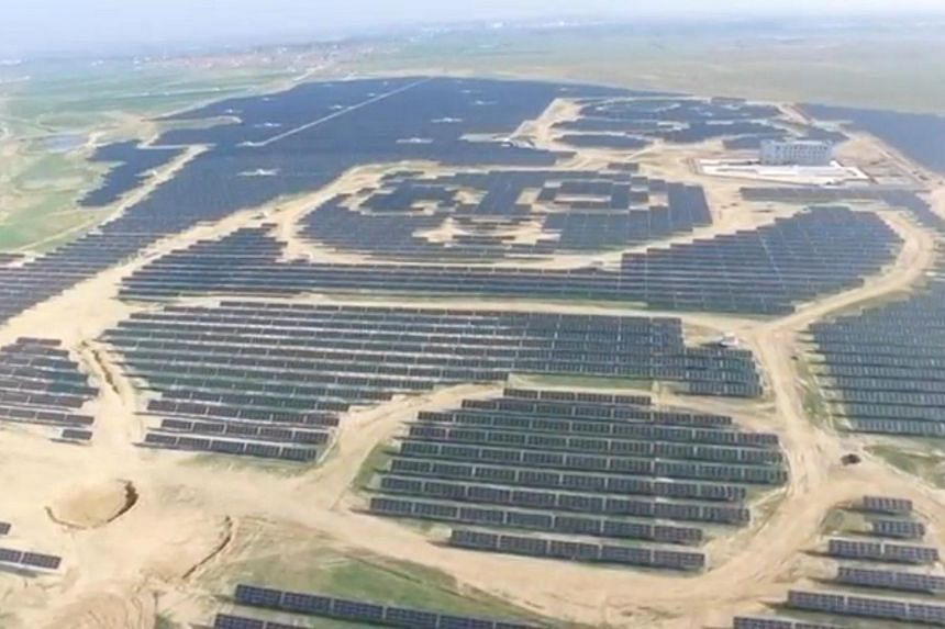 An aerial view of panda-shaped solar plants built by Panda Green Energy Group in Datong, Shanxi province, China.