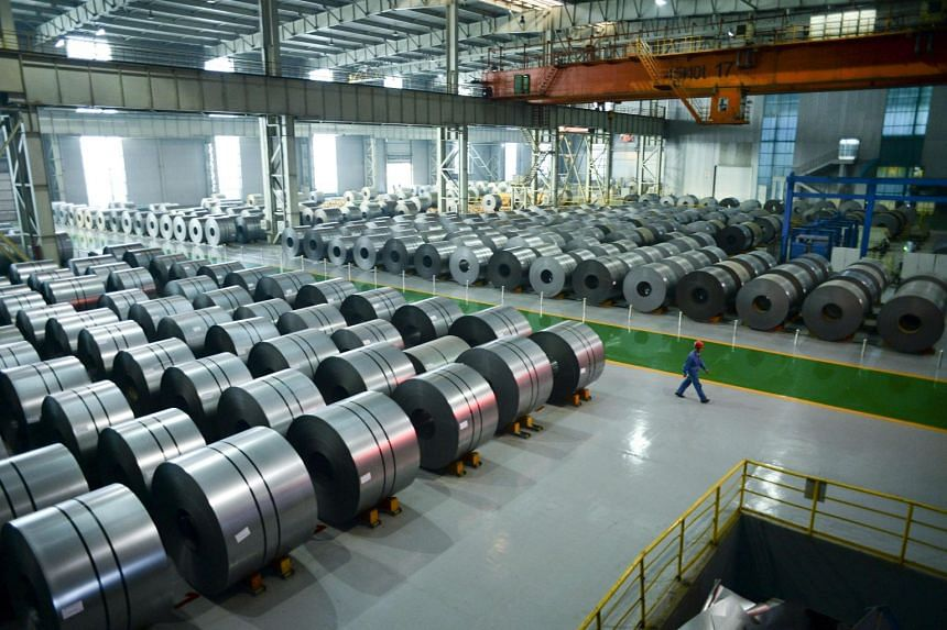 A worker walking through a warehouse at the Han-steel plant in Handan in China's northern Hebei province.