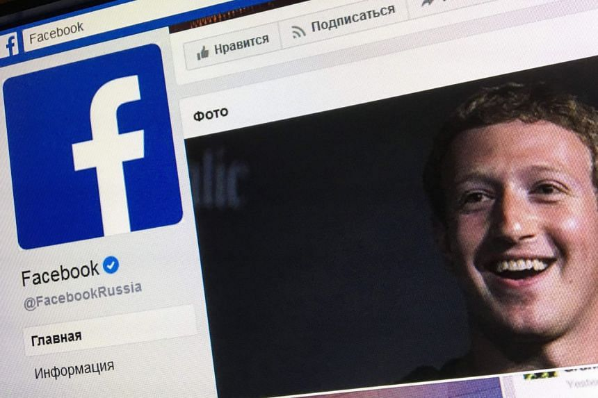 An illustration picture of the Russian language version of Facebook, featuring Zuckerberg.
