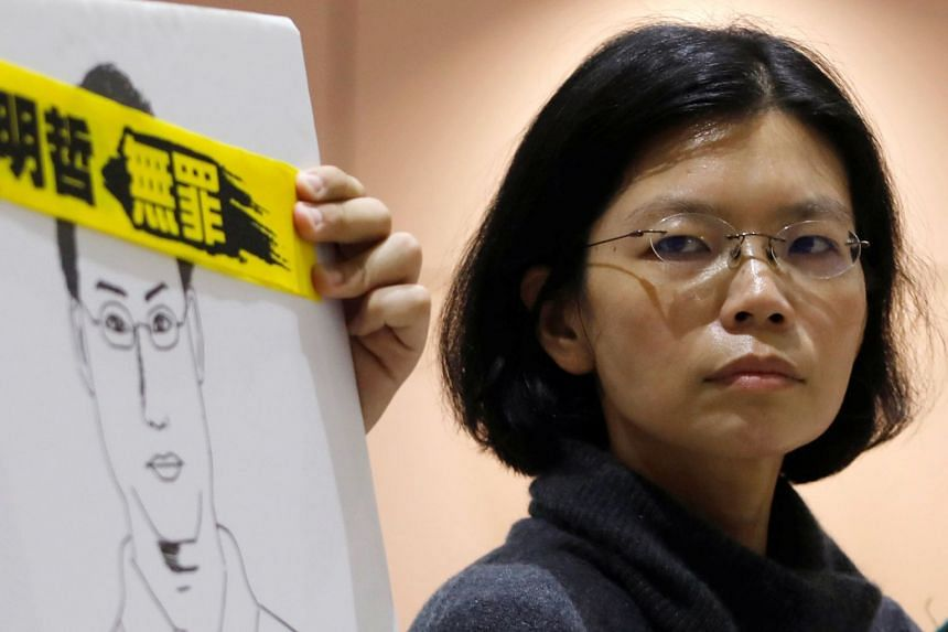 Lee Ching-yu, wife of Taiwan human rights advocate Lee Ming-che, speaks to the media as she returns from China after visiting her husband, at Taoyuan International Airport, Taiwan on March 28, 2018.
