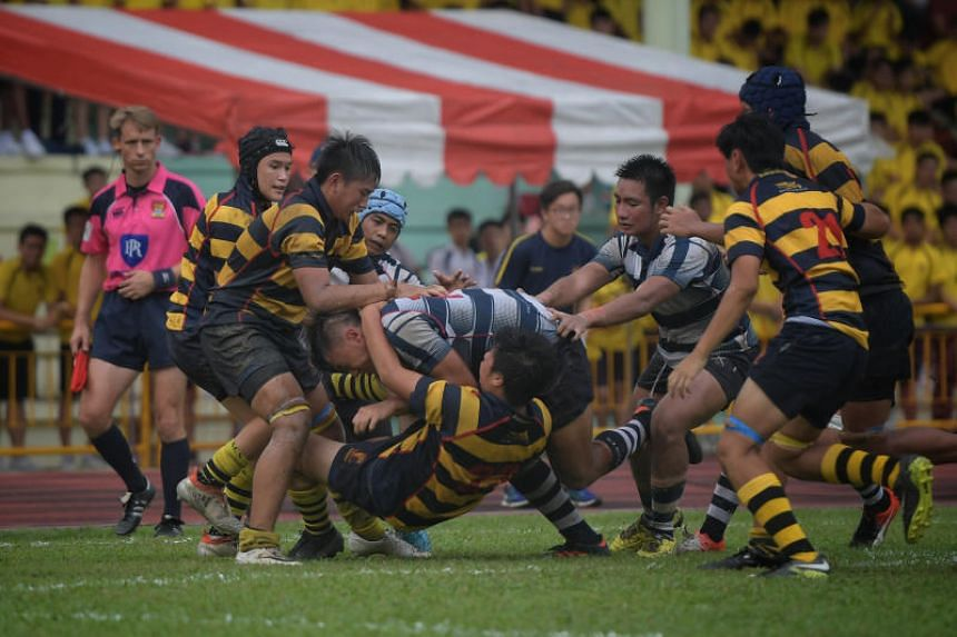 St Andrew's Secondary School's B Division rugby team (in blue and white) won 13-10 against Anglo Chinese School (Independent) to claim their first title after a three-year drought.
